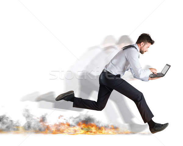 Rápido negocios empresario rápidamente portátil fuego Foto stock © alphaspirit