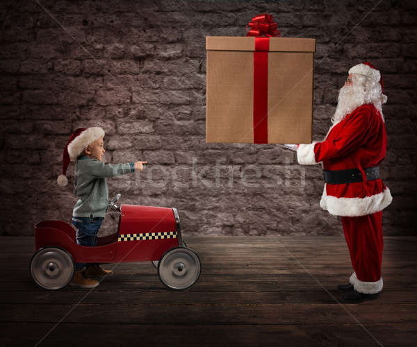 Santa Claus deliver a CHristmas gift to a child Stock photo © alphaspirit