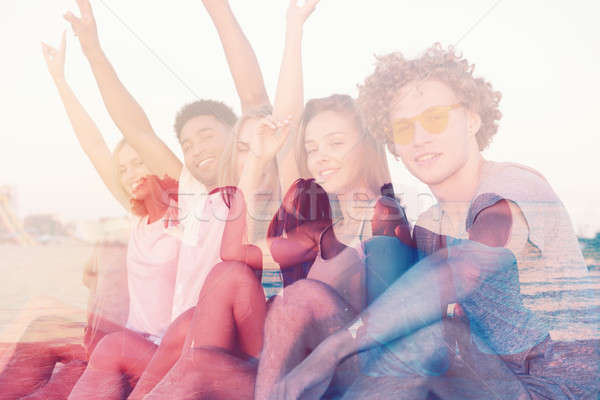Group of happy friends having fun at ocean beach. double exposure Stock photo © alphaspirit