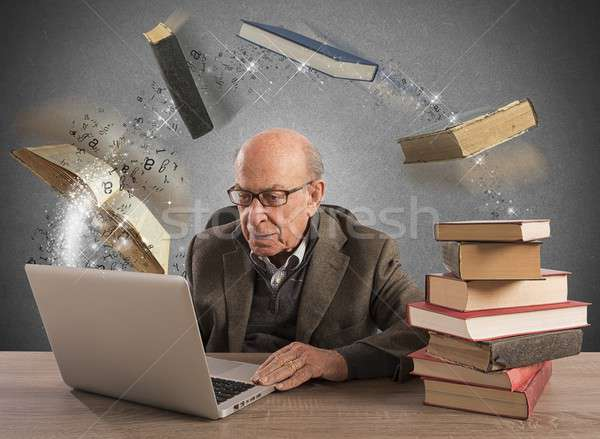 Ebook for aged man Stock photo © alphaspirit