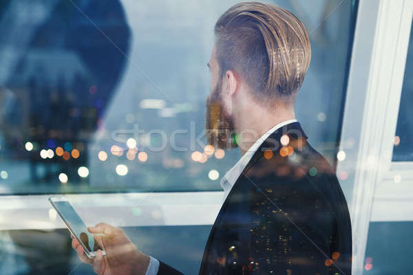 Businessman looks far for the future into the night. Concept of innovation and startup Stock photo © alphaspirit