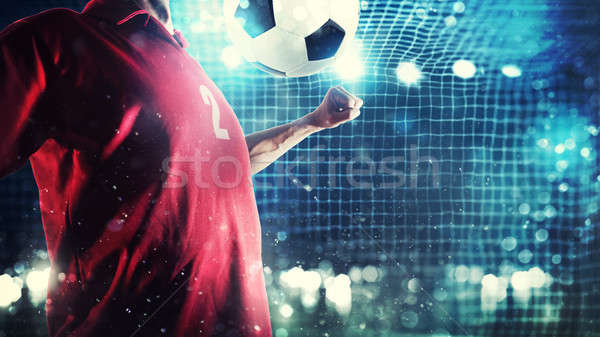 Striker player controls the ball near the football goal Stock photo © alphaspirit
