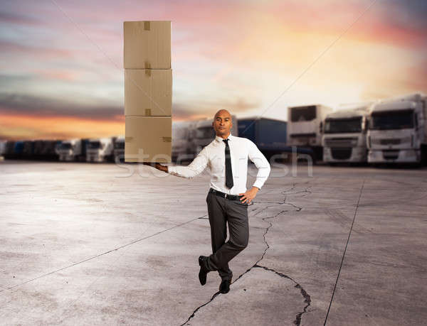 Businessman holds a pile of packages in a hand. concept of fast delivery Stock photo © alphaspirit