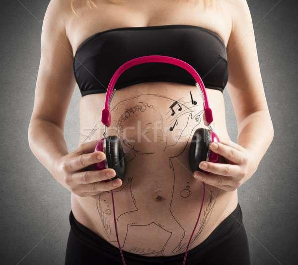 Unborn baby listen to music Stock photo © alphaspirit