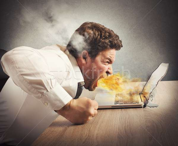 Angry businessman spits fire Stock photo © alphaspirit