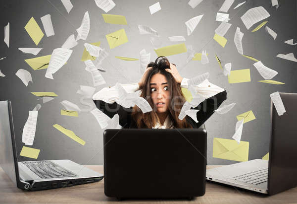 Businesswoman stressed by spam Stock photo © alphaspirit