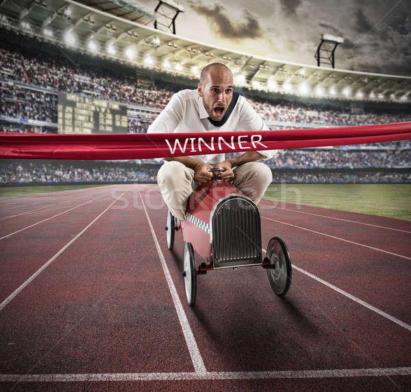 Successful businessman on the finishing line Stock photo © alphaspirit