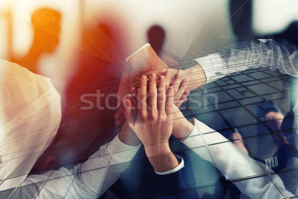 Business people joining hands in the office. concept of teamwork and partnership. double exposure Stock photo © alphaspirit
