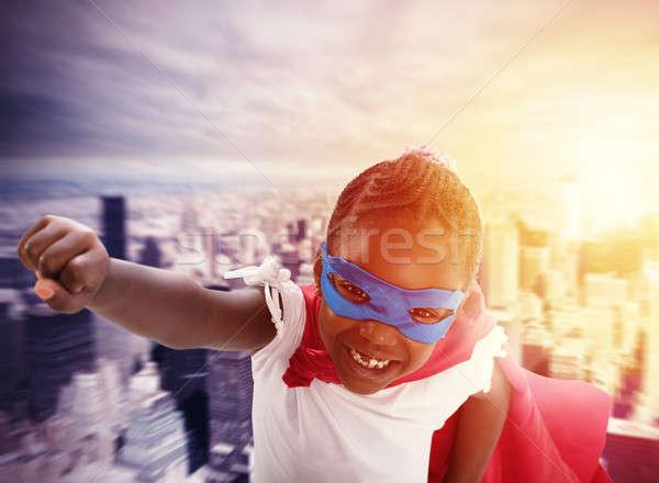 Child acts like a superhero to save the world Stock photo © alphaspirit