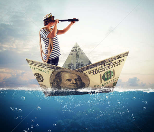 Sailor on banknote boat Stock photo © alphaspirit