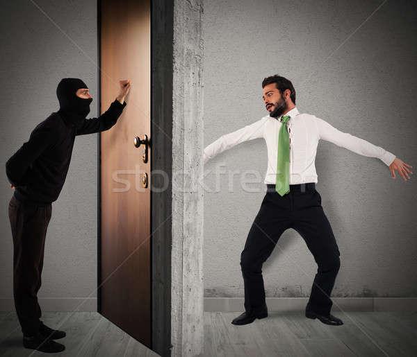 Kibar hırsız kapı daire ev adam Stok fotoğraf © alphaspirit