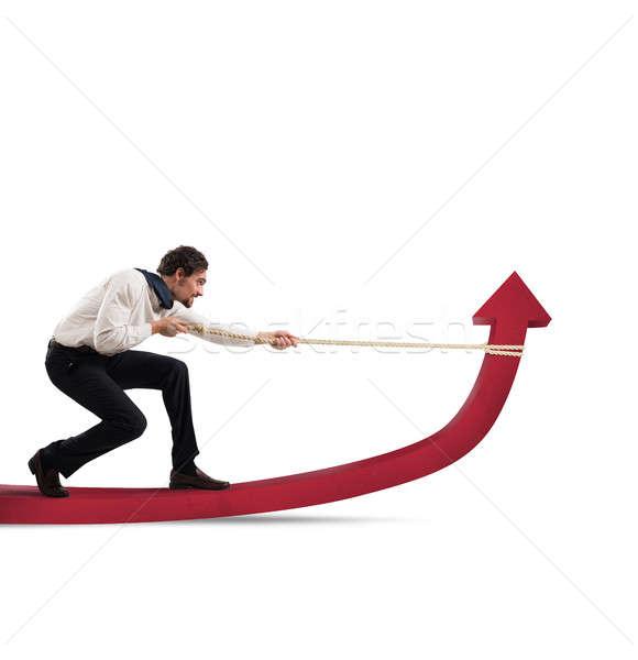 Stock photo: Businessman changes statistics