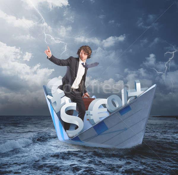 Fora crise financeira homem papel barco tempestuoso Foto stock © alphaspirit