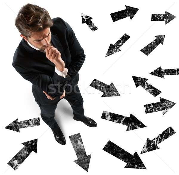 Undecided businessman Stock photo © alphaspirit