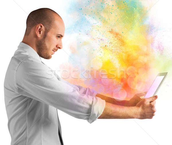 Tablet Farbe Burst hellen farbenreich Mann Stock foto © alphaspirit