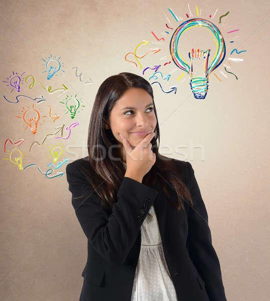 Zseniális ötlet sok ötletek üzletasszony munka Stock fotó © alphaspirit