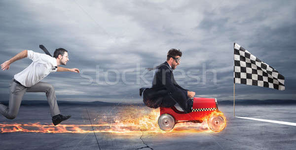 Fast businessman with a car wins against the competitors. Concept of success and competition Stock photo © alphaspirit