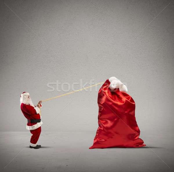 Heavy bag of gifts Stock photo © alphaspirit