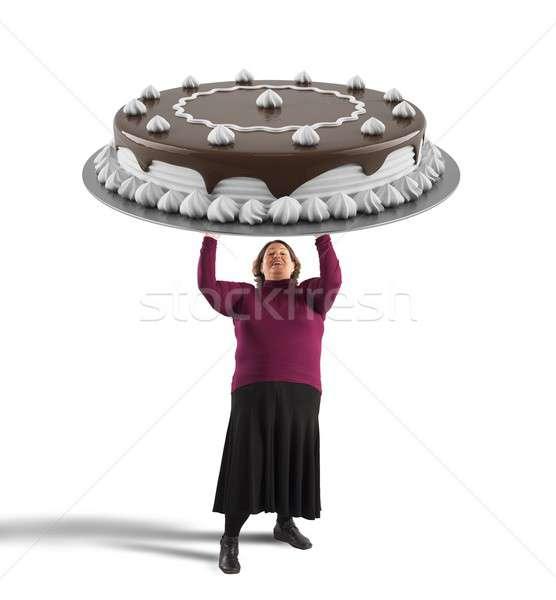 Grande pastel de chocolate grasa mujer alimentos Foto stock © alphaspirit