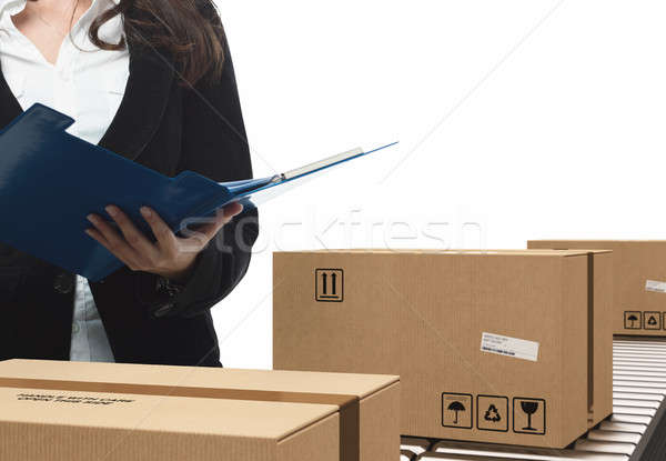 Businesswoman checks boxes on conveyor roller Stock photo © alphaspirit