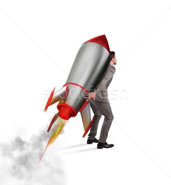 Determination and power businessman that holds a rocket isolated on white background Stock photo © alphaspirit