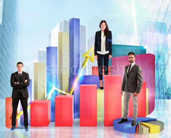 Business team on financial graphs and statistics Stock photo © alphaspirit