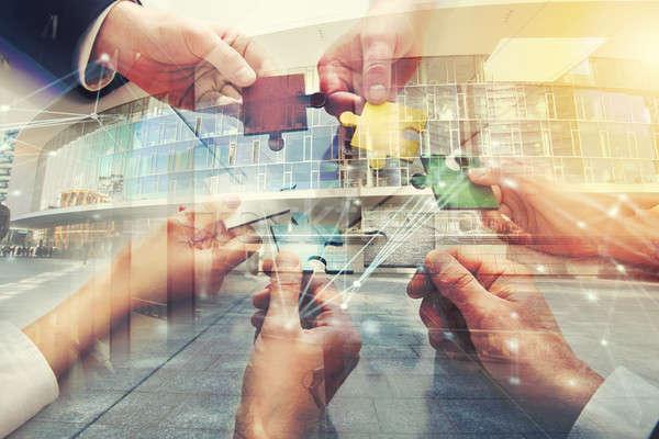 Csapatmunka partnerek integráció startup kirakó darabok dupla Stock fotó © alphaspirit