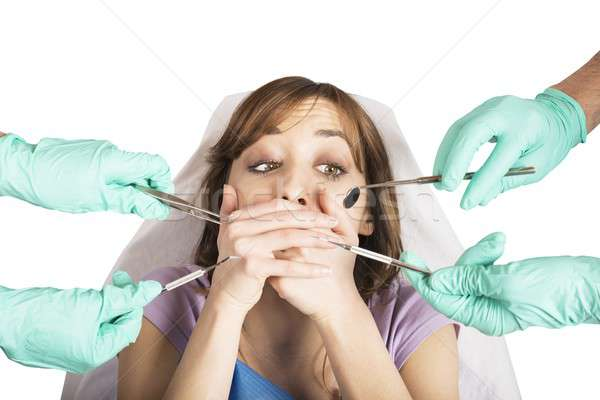 Girl frightened by dentists Stock photo © alphaspirit