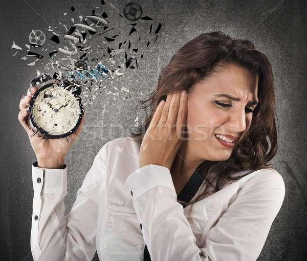 Infastidito allarme donna suono clock tempo Foto d'archivio © alphaspirit