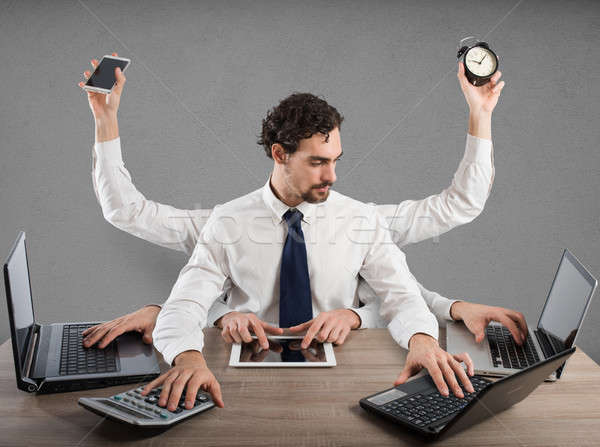 Businessman multitasking Stock photo © alphaspirit