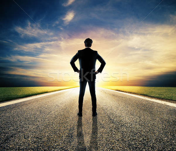 Businessman walks on an unknown road for a new adventure Stock photo © alphaspirit
