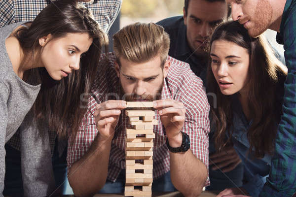 Team of business people build a wooden construction. concept of teamwork ,partnership and company st Stock photo © alphaspirit