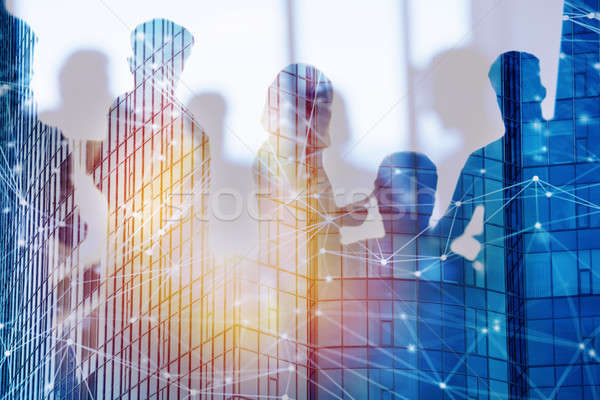 Businessmen that work together in office with network effect. Concept of teamwork and partnership. d Stock photo © alphaspirit