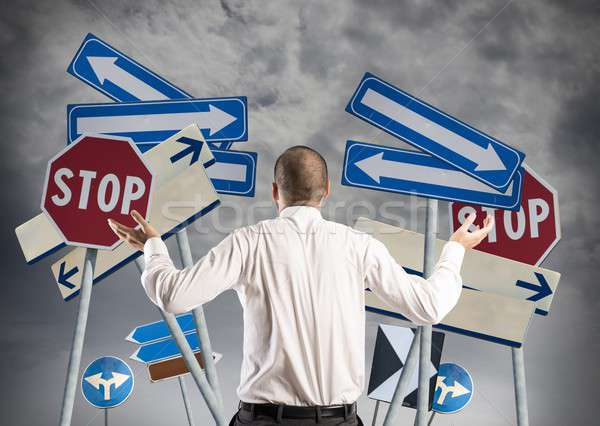 Choices and confusion of a businessman Stock photo © alphaspirit