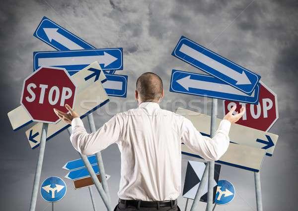 Lehetőségek zavarodottság üzletember férfi felirat állás Stock fotó © alphaspirit