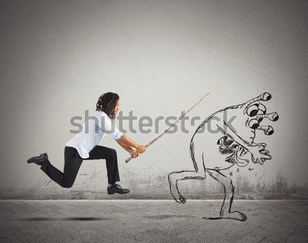 Man chasing a flu virus Stock photo © alphaspirit