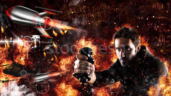 Man plays with videogames with joystick a war battle Stock photo © alphaspirit