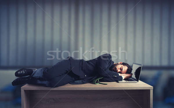 Businessman sleeping over a desk due to overwork Stock photo © alphaspirit
