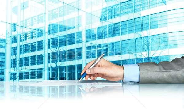 Businessman signing a document Stock photo © alphaspirit