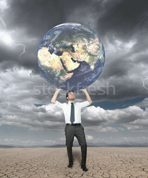 Businessman protects the world  Stock photo © alphaspirit