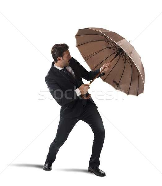 Businessman with umbrella Stock photo © alphaspirit