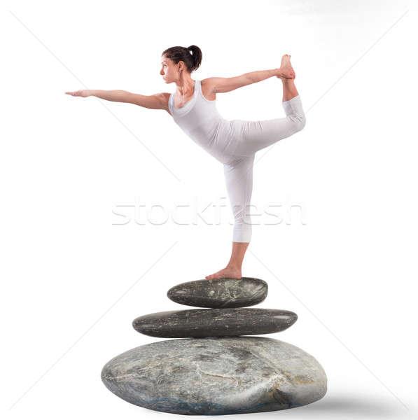 Pilates pozició kő rugalmas nő sport Stock fotó © alphaspirit