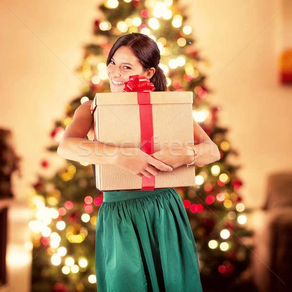 Karácsony ajándék boldog nő nagy fények Stock fotó © alphaspirit