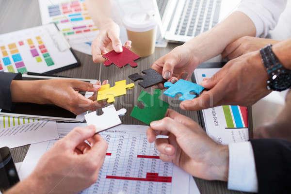 Teamwerk partners integratie startup puzzelstukjes zakenlieden Stockfoto © alphaspirit