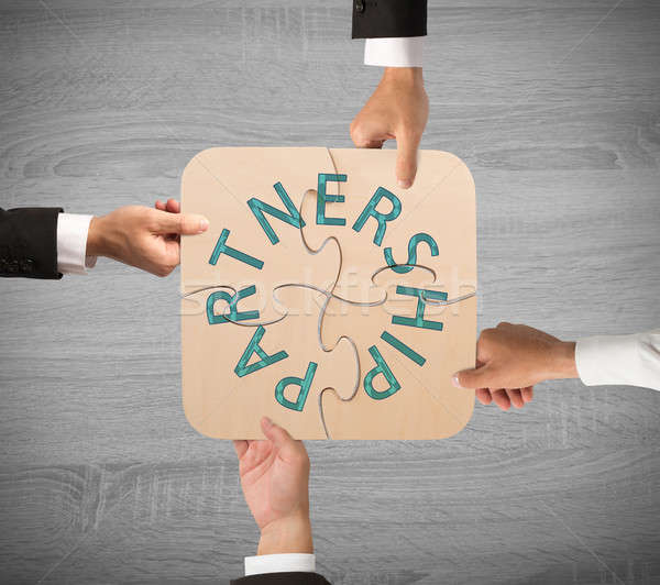Business partnership puzzle Stock photo © alphaspirit