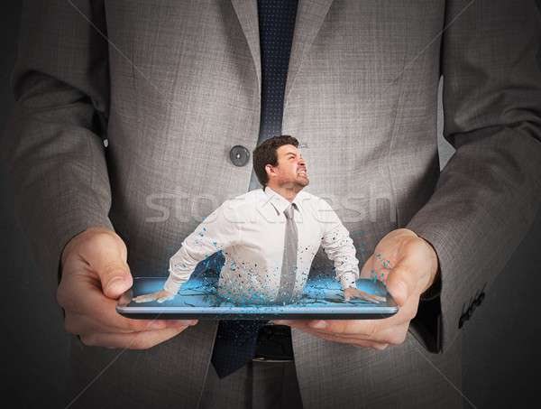 Trapped by technology Stock photo © alphaspirit
