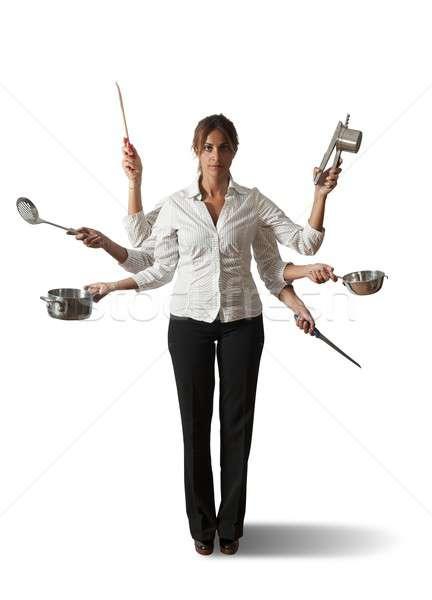Multitasking donna cucina business ragazza lavoro Foto d'archivio © alphaspirit