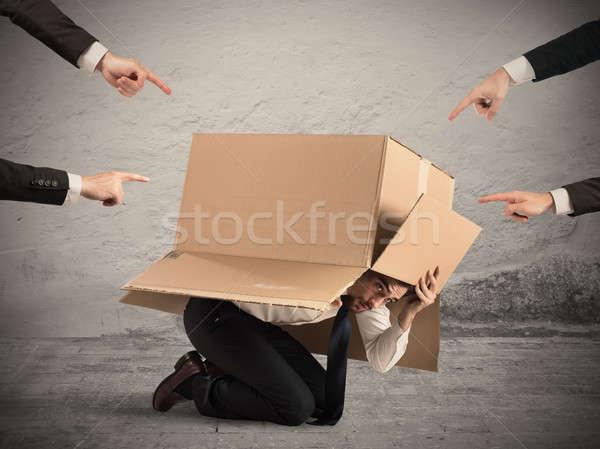 Colpevole imprenditore colleghi nascondere cartone uomo Foto d'archivio © alphaspirit