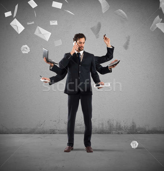 Stock photo: Multitasking businessman