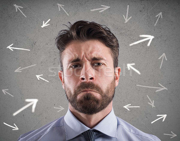 Difficult choices of a businessman. concept of confusion Stock photo © alphaspirit